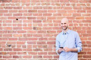 Nick Loper headshot brick wall